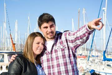 Young woman and young man on a marina