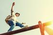 Leinwanddruck Bild - traveler walking balance over top of wooden construction