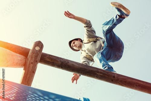 Leinwandbild Motiv traveler walking balance over top of wooden construction