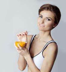 athletic girl energetic happy drinking orange juice