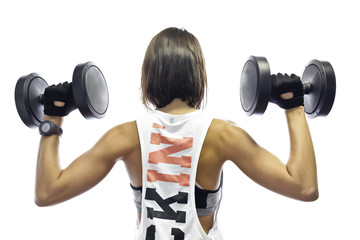 Girl training with dumbells