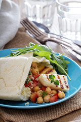 Pita bread with couscous and chickpeas