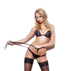 Sensual blonde woman in underwear with whip