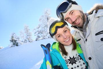 Portrait of cheerful couple in snowy mountain