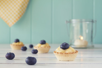Tartlets with blueberries and pastry cream. Vintage Style.