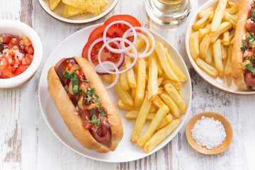 fast food - hot dog with French fries and chips, top view