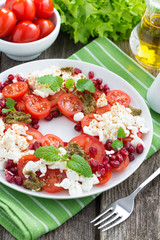 fresh salad with tomatoes, cottage cheese, mint pesto