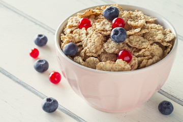 A healthy breakfast: cereals with blueberries and red currants