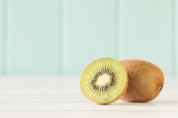 Kiwi on a white wooden table. Vintage Style.