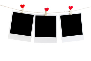 Three Old picture frame hanging on the clothesline over white