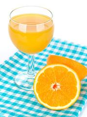 Orange juice glass and oranges