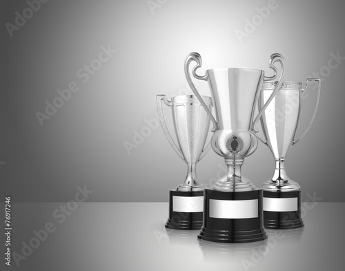 silver trophies on gray background - 76917246