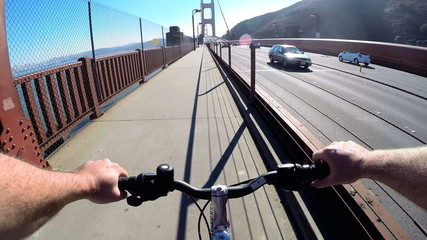 POV Cycle rider Golden Gate Bridge traffic San Francisco USA