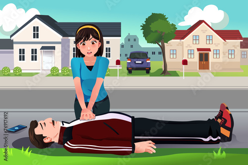 Teenager giving a CPR to a middle aged man - 76917692