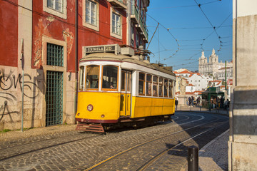 "Lisbon, Portugal, Europe - Traditional Tram passing in ""portas d"