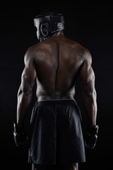 Back of strong young male boxer