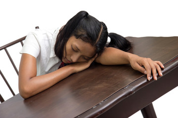 student sleeping at a desk