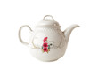 Porcelain teapot with floral patterns over  white