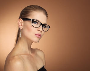 Fashion portrait of young glamour female in optical eyewear.