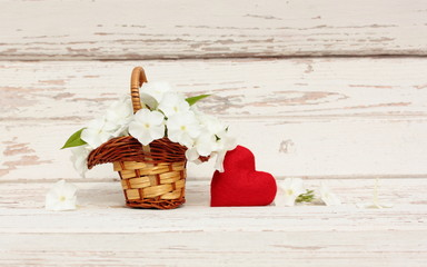 Bouquet Phlox flowers in basket and red felt heart