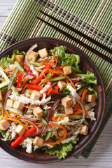 Japanese tofu salad with fresh vegetables vertical top view