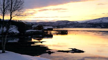 Tromso Fjord Northern Norway winter daylight frozen landscape fading sunlight