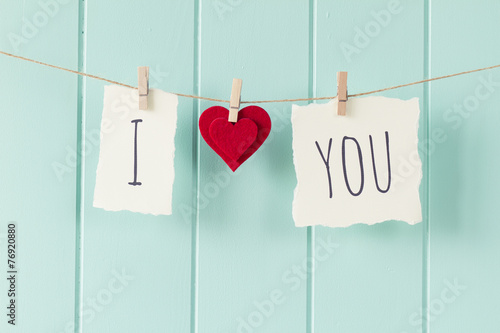 """Leinwanddruck Bild """"I love you"""" hanging on a rope with clothespins. Vintage Style."""