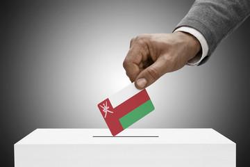 Ballot box painted into national flag colors - Oman