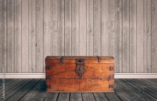 Treasure chest on a wooden floor - 76921684