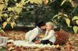golden autumn forest picnic, boy in a hat with a cute little gir