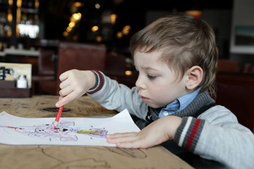 Child drawing at cafe
