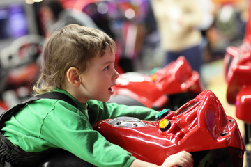 Child on motorcycle simulator
