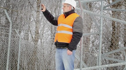 Worker filmed with tablet PC at outdoors
