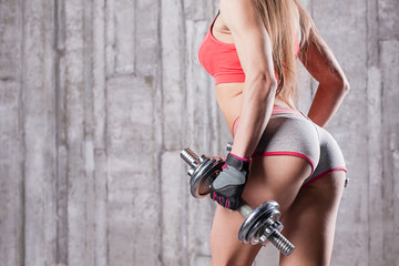 young girl with dumbbells and taut buttocks