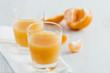 Tangerine juice on the table