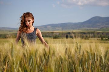 young beautiful woman  in the Toscana field