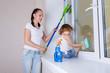 Family washing windows.