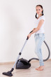 Young woman with vacuum cleaner.