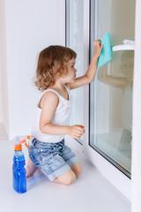 Child washing windows.