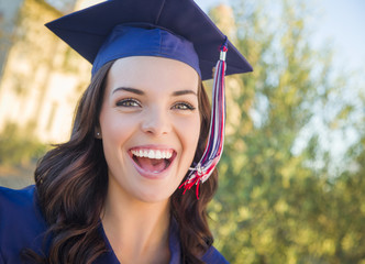 Happy Graduating Mixed Race Woman In Cap and Gown