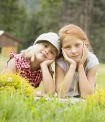 two young beautiful girls smiling