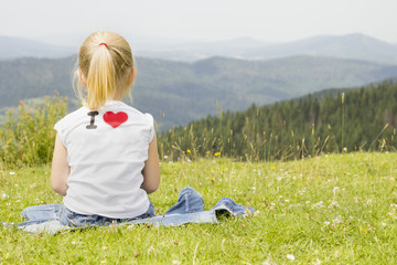 girl sitting on a mountain top