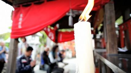 Fushimi Inari Taisha shrine praying sacred burning candles Kyoto