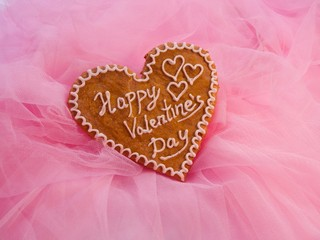 Saint Valentine's hearts from gingerbread on taffeta surface