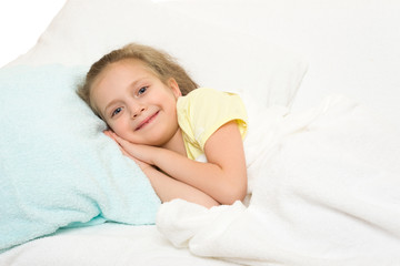 little girl in bed