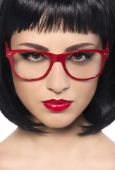 Beautiful young woman with red glasses.
