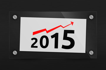 Behind glass sheet of paper with a optimistic 2015 year graph