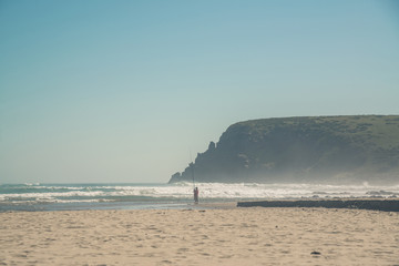 Man fishing at the beach of Morgans Bay. Eastern Cape. South Afr