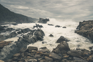 The wild coast of Tsitsikamma National Park with rocks and big w