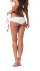 Rear view of harmonous girl with measuring tape